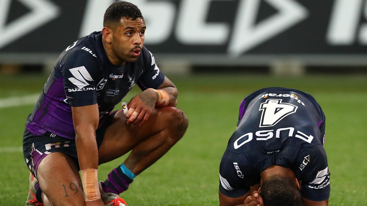 A shattered Josh Addo-Carr and Justin Olam after their golden point defeat. Picture: Kelly Defina