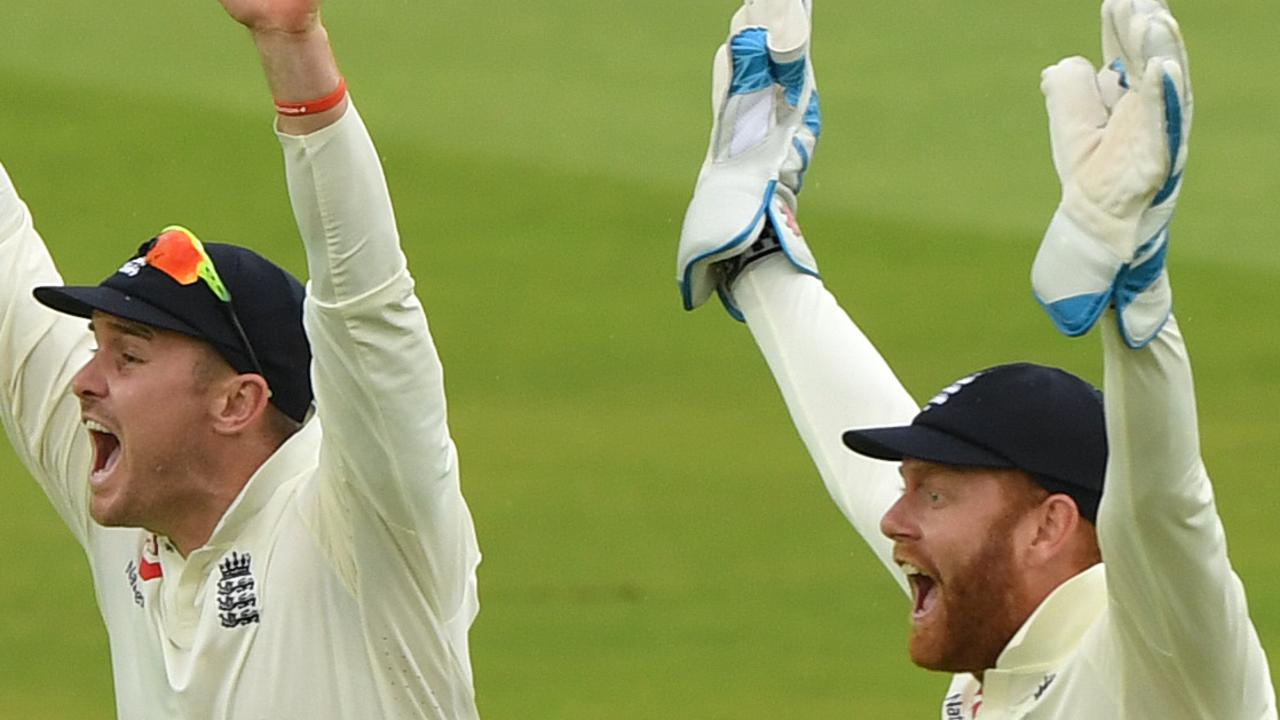 England wicketkeeper Jonny Bairstow and Jason Roy celebrate after Stuart Broad's dismissal of Kevin O'Brien  at Lord's on Friday. Picture: Stu Forster/Getty Images