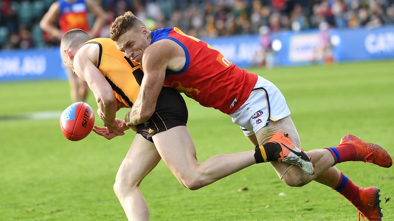 Hawthorn's Tom Scully is caught by Mitch Robinson. Picture: AAP