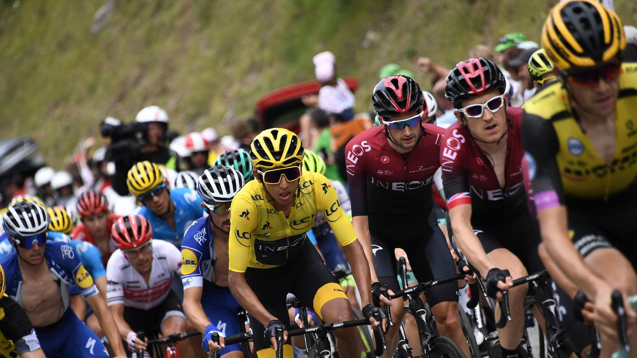 Great Britain's Geraint Thomas (2R) and Colombia's Egan Bernal (C), wearing the overall leader's yellow jersey, followed by France's Julian Alaphilippe ride in the pack during the twentieth stage of the 106th edition of the Tour de France. Picture: Jeff Pachooud/AFP
