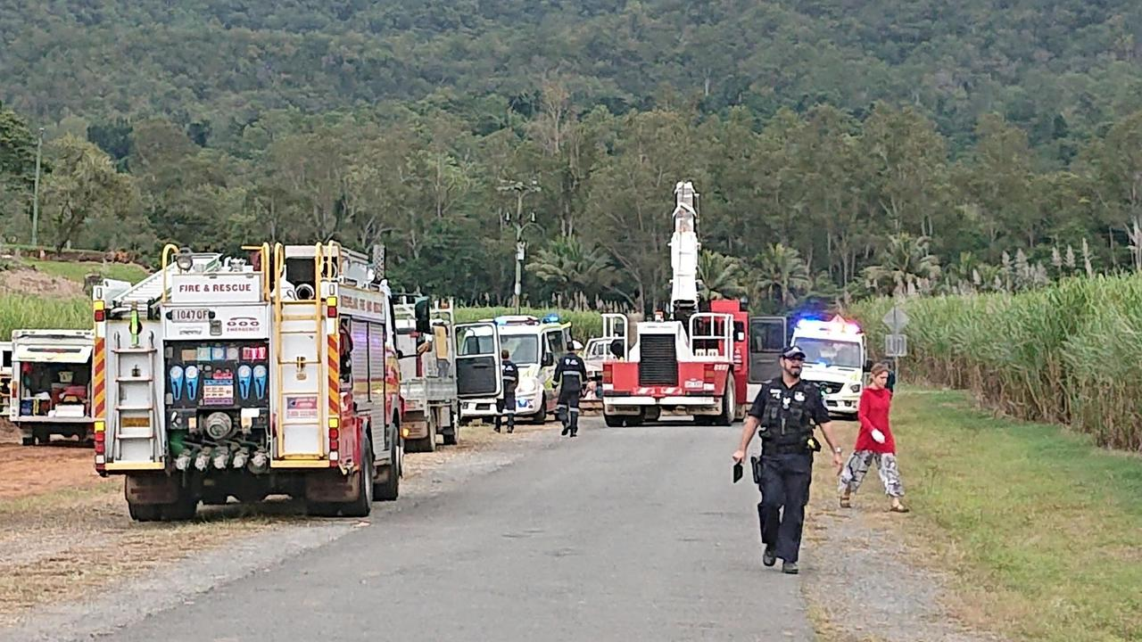 Paramedics, firefighters and police on scene at Little Mulgrave Rd in Goldsborough after a crane hit a powerline. PICTURE: ANNA ROGERS