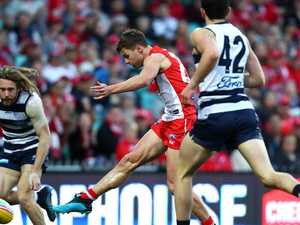 Milestone man Hawkins fires Cats past Swans