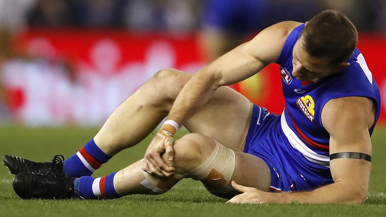 It was a sad sight on Marvel Stadium when Bulldogs favourite son Dale Morris went down with a knee injury in his AFL comeback. Picture: AFL Photos