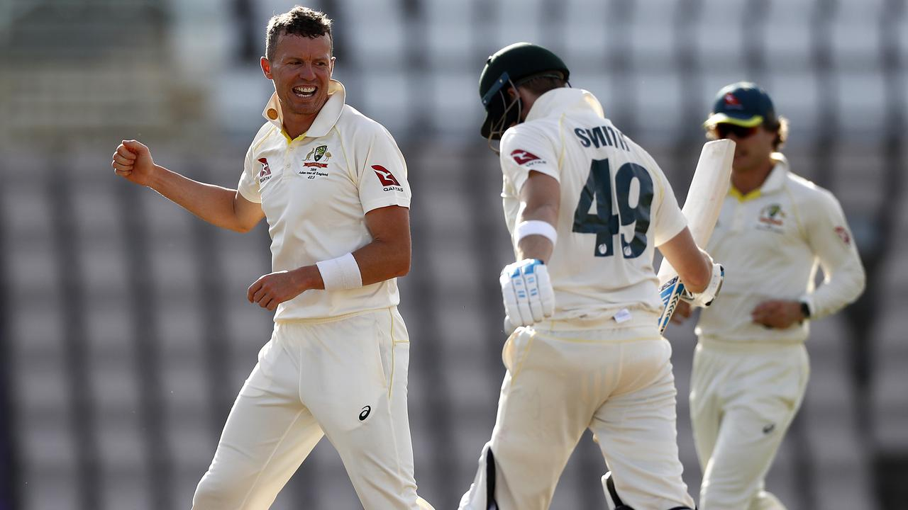 Peter Siddle celebrates after taking the wicket of Steve Smith in the All-Australian tour match,