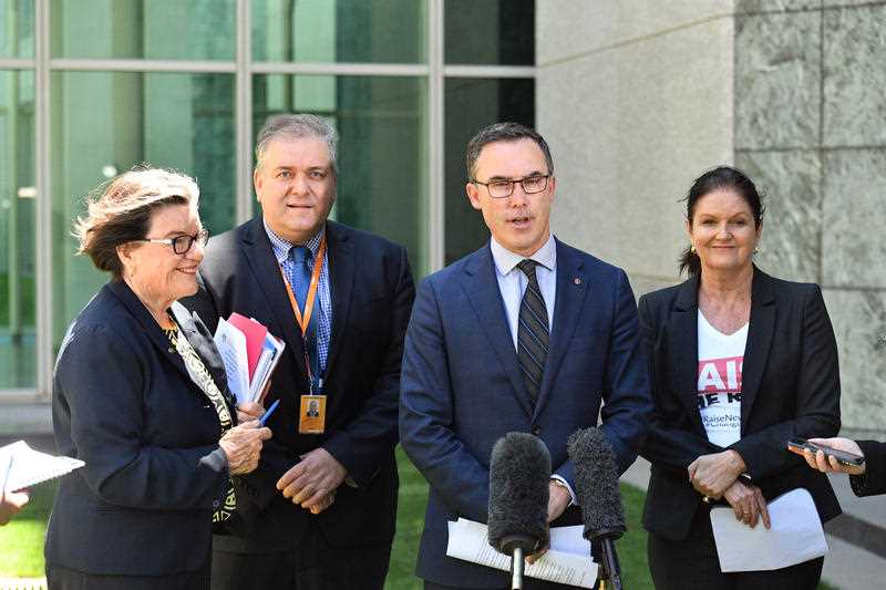 (L-R) Independent Member for Indi Cathy McGowan, Catholic Social Services Australia Deputy CEO Joe Sabor, Independent Senator Tim Storer and Australian Council of Social Services CEO Cassandra Golding speak on the Social Security Commission Bill at a press conference at Parliament House in Canberra, Monday, December 3, 2018.