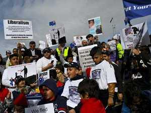 Refugees rally against temporary visas