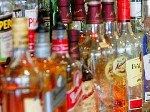 Man sculls rum, threatens staff in bizarre bottle-o robbery