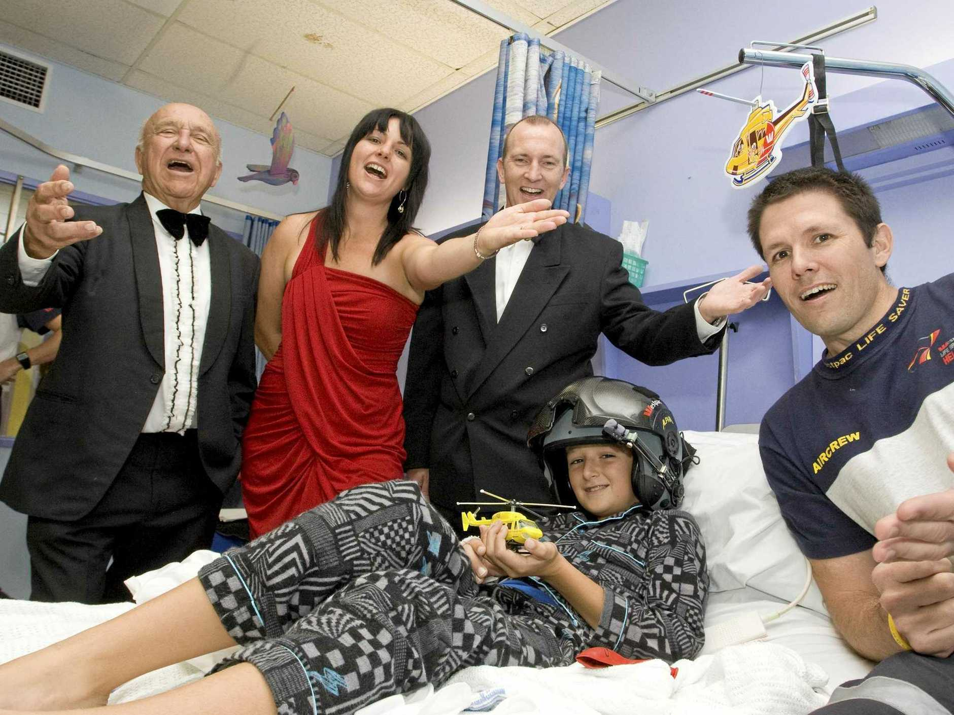 (l-r) Geoff Cawley , Rebekka Battista, from Our Kids, Kevin Poole, from the Opera at The Channon and  Westpac Life Saver Rescue Helicopter crewmen, Patrick Wallbridge,  pose for a portrait with Dylan Parks, 10 from Clunes, at the childrens ward at the Lismore Base Hospital, ahead of the Opera at The Channon in July. Photo Jerad Williams / The Northern Star