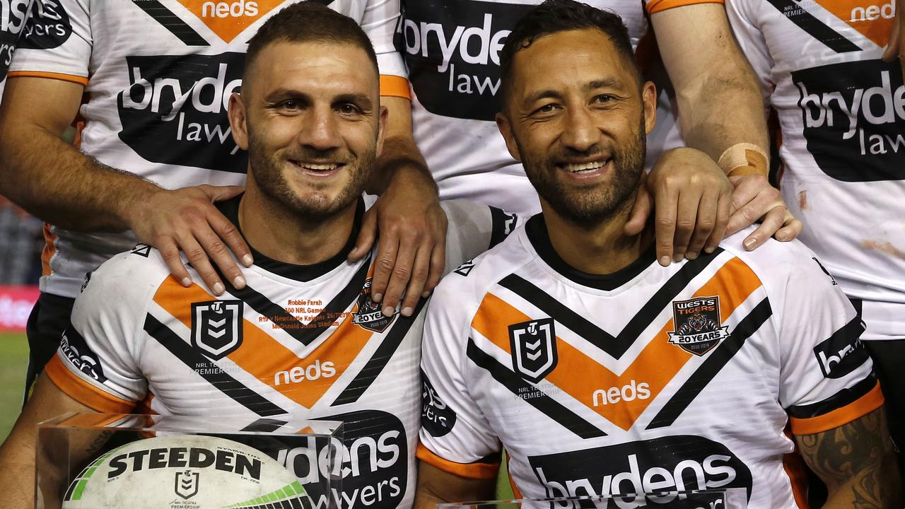 Wests Tigers legend Robbie Farah and Benji Marshall were honoured after the Knights win. Picture: AAP