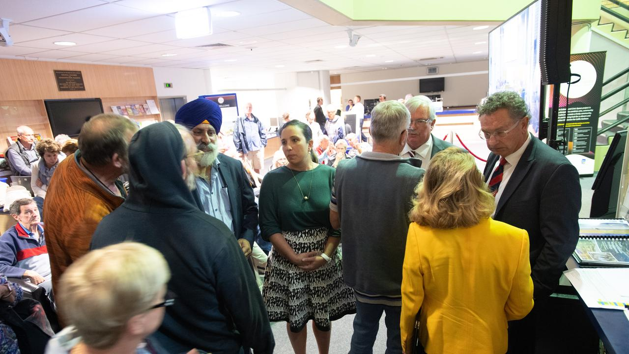 Councillors John Arkan, Tegan Swan, Keith Rhoades and Paul Amos speaking with members of the community after walking out of last week's meeting.