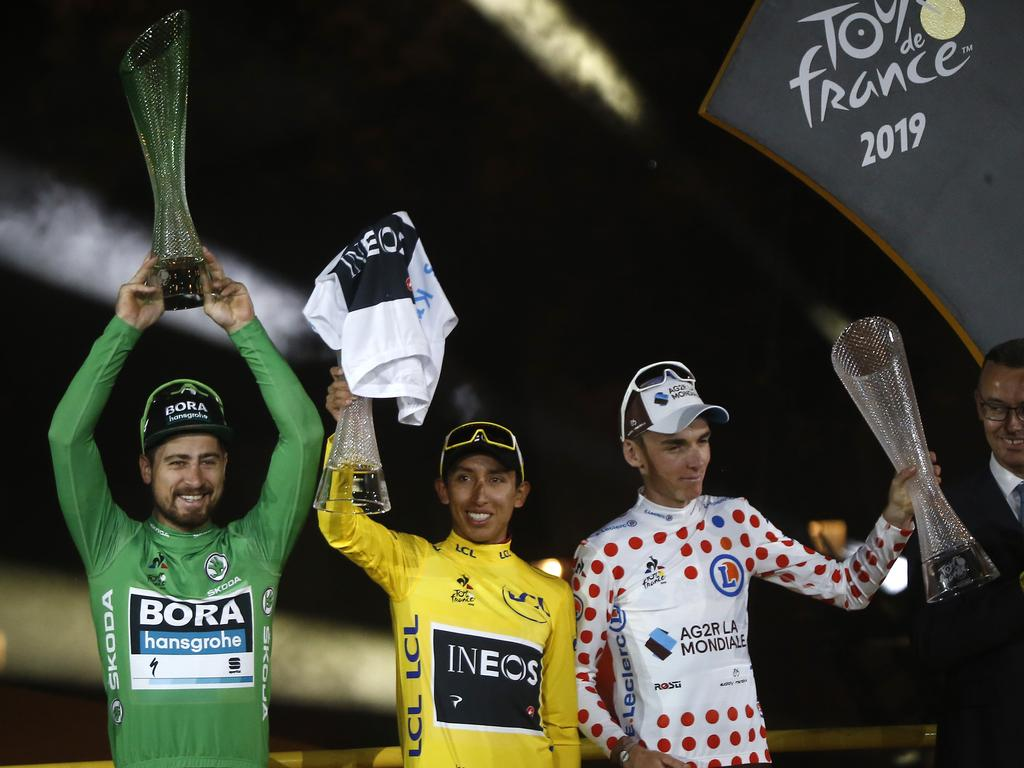 Colombia's Egan Bernal, the winner, centre, Slovakia's Peter Sagan wearing the best sprinter's green jersey, left, and France's Romain Bardet wearing the best climber's dotted jersey. Picture: AP Photo/Michel Euler