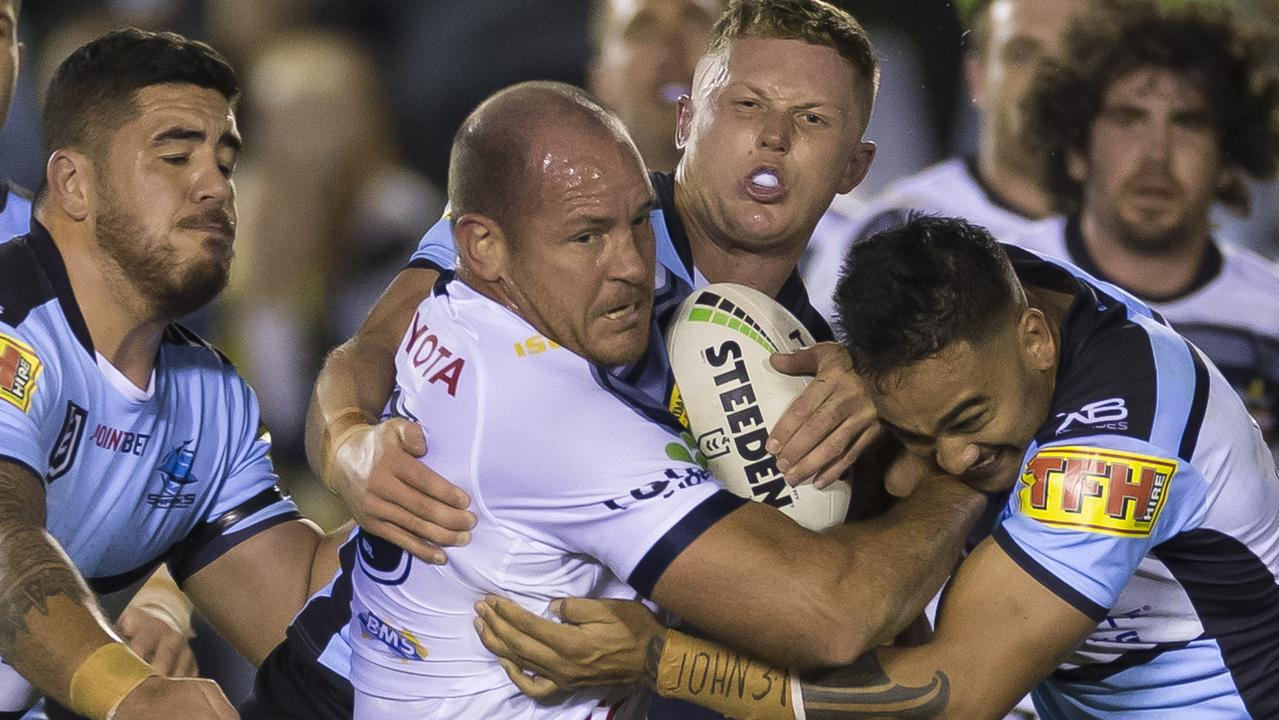 Matthew Scott of the Cowboys is tackled during the Round 19 NRL match between the Cronulla Sharks and the North Queensland Cowboys at Pointsbet Stadium in Sydney, Thursday, July 25, 2019. (AAP Image/Craig Golding) NO ARCHIVING, EDITORIAL USE ONLY