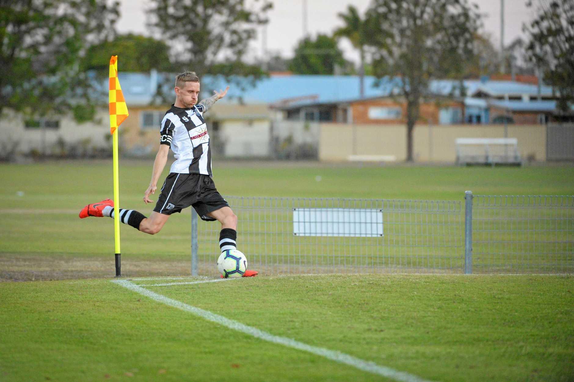STRIKE: Bingera's Daniel Watson  takes a corner kick against Brothers Aston Villa on Saturday.