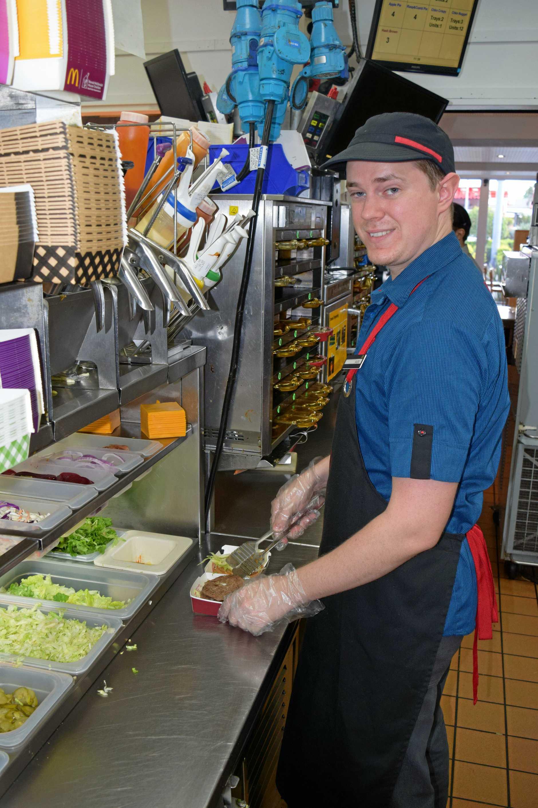 Building a Big Mac is Maryborough McDonald's kitchen crew trainer Alex White.