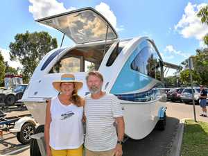 Travellers happy to put their caravan into a river