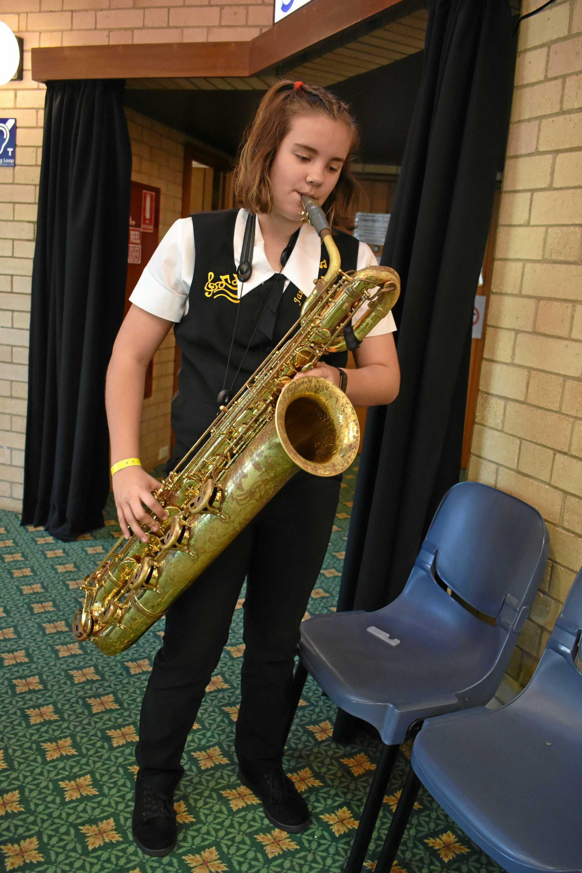 Phoebe Penny prepares for the saxophone ensemble event