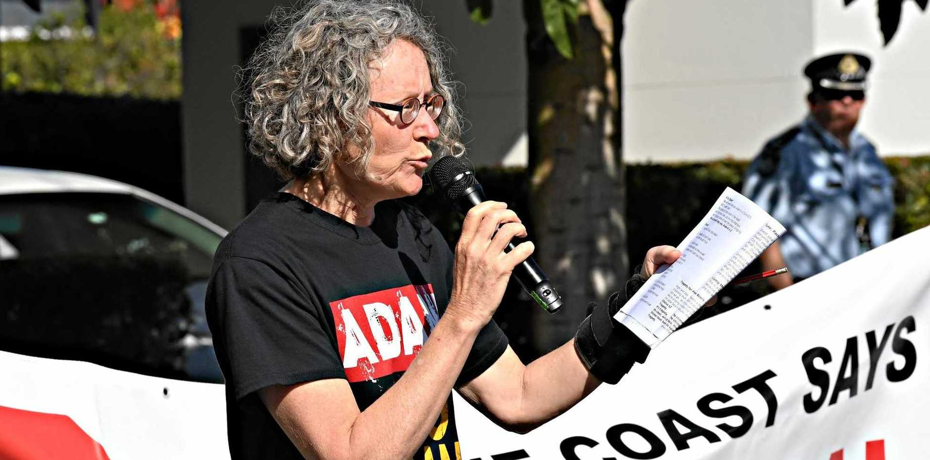 ACTIVISM: Protestor Jenny Fitzgibbon speaks to a crowd in front of GHD's Sunshine Coast office.