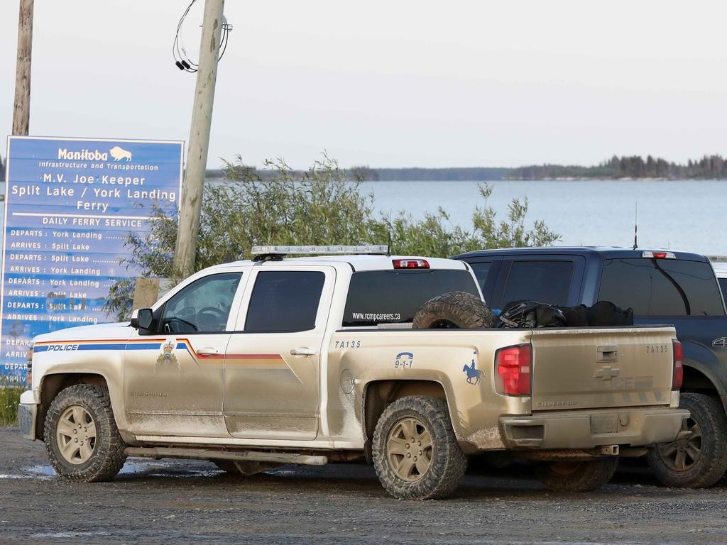 Police waiting to get onto the ferry at Split Lake to York Landing at first light as the manhunt continues for Bryer Schmegelsky, 18 and Kam McLeod, 19. Picture: Clint Brewer