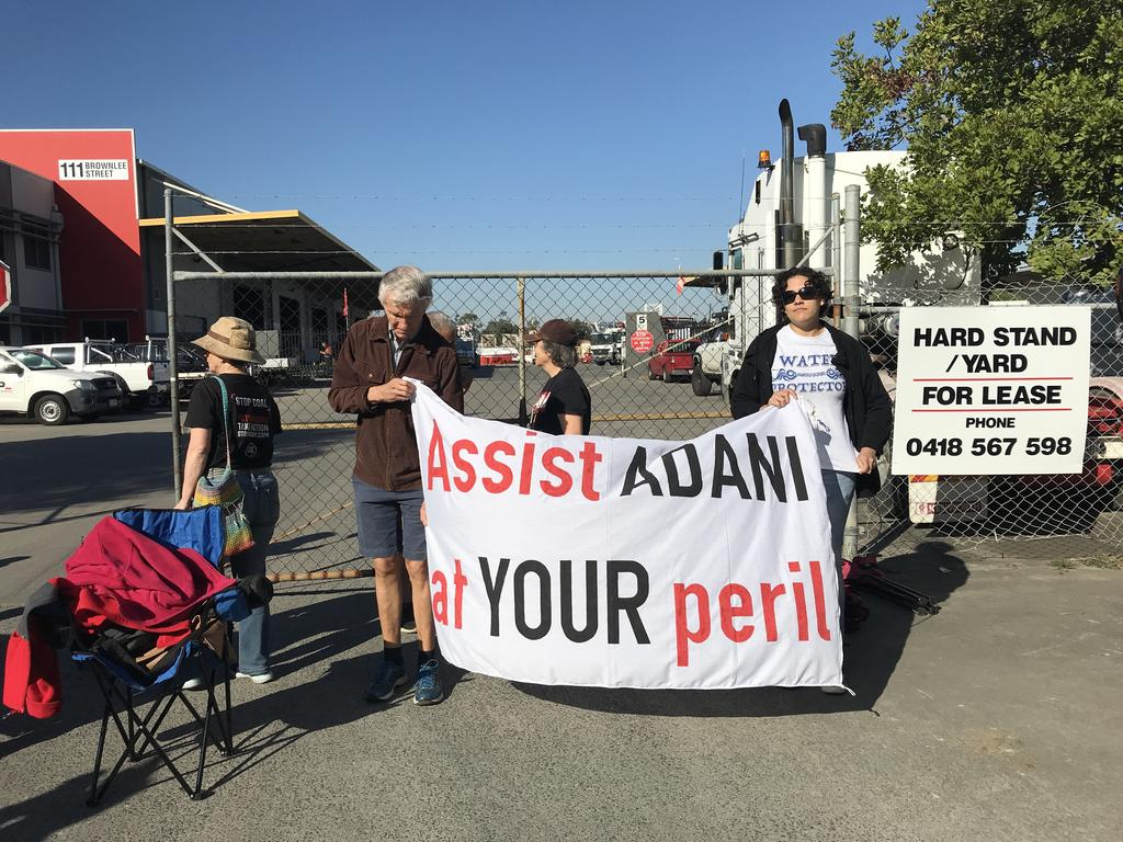 Anti-Adani protesters form a blockade at the Brisbane site owned by Specialised Concrete Pumping.