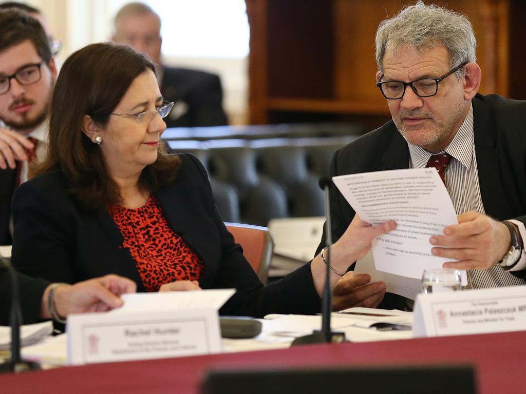 Premier Annastacia Palaszczuk speaks with chief-of-staff David Barbagallo during Estimates hearings.