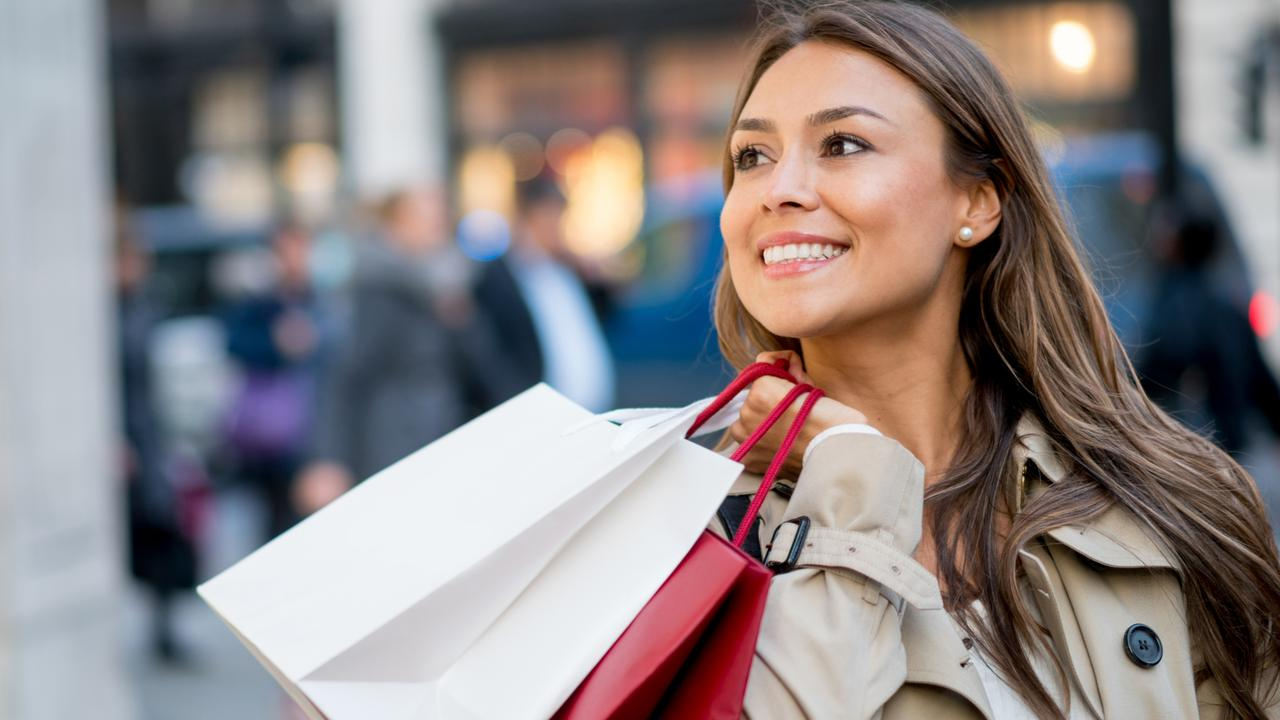 A woman carrying her shopping bags after spending money on her credit card. Picture: iStock.
