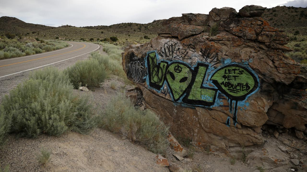 Alien-themed graffiti adorns a rock along the Extraterrestrial Highway near Rachel, Nevada, the closest town to Area 51. Picture: AP/John Locher.