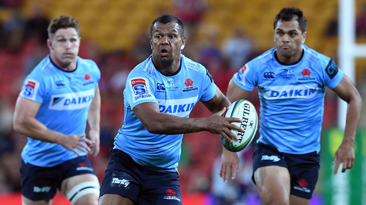 Kurtley Beale of the Waratahs (centre) is seen during the Round 14 Super Rugby match between the Queensland Reds and the NSW Waratahs at Suncorp Stadium in Brisbane, Saturday, May 18, 2019. (AAP Image/Dan Peled) NO ARCHIVING, EDITORIAL USE ONLY