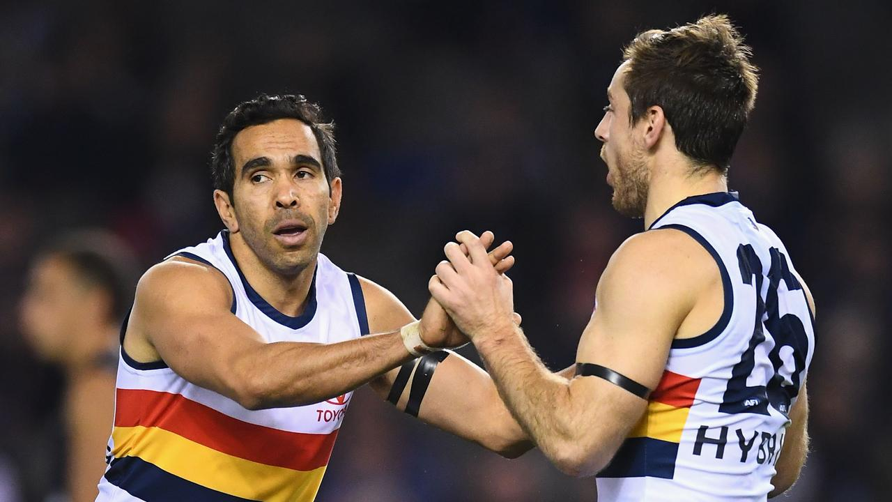 Eddie Betts celebrates a goal with Adelaide teammate Richard Douglas. Picture: Quinn Rooney/Getty Images.