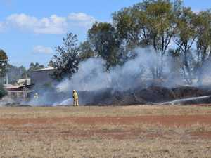 Mound of materials set alight near empty block of land