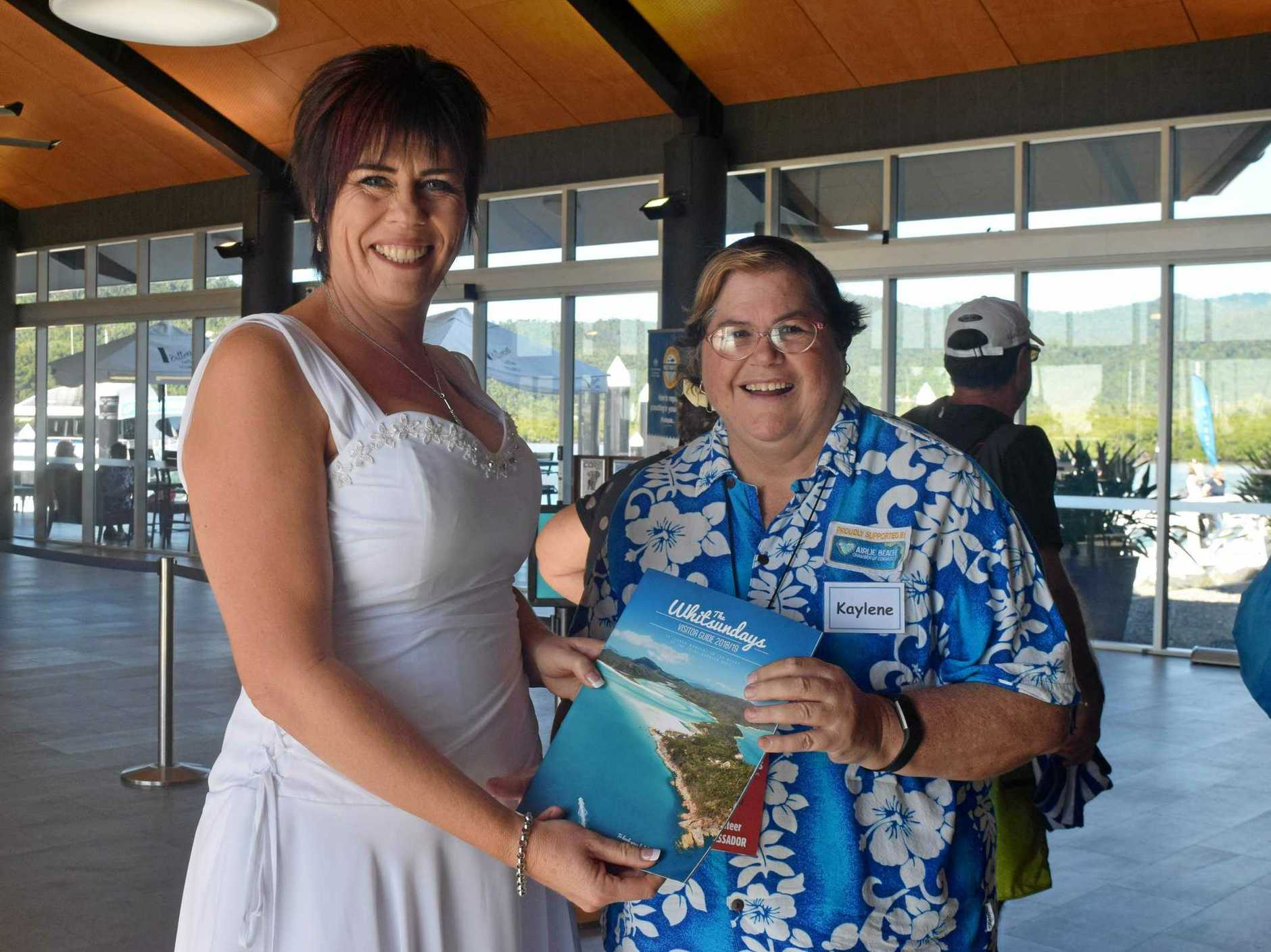 THE PEOPLE YOU MEET: Kaylene Giles is the newest face with the Airlie Beach Cruise Ship Ambassadors, and she met bride Vanessa Davidson on duty.