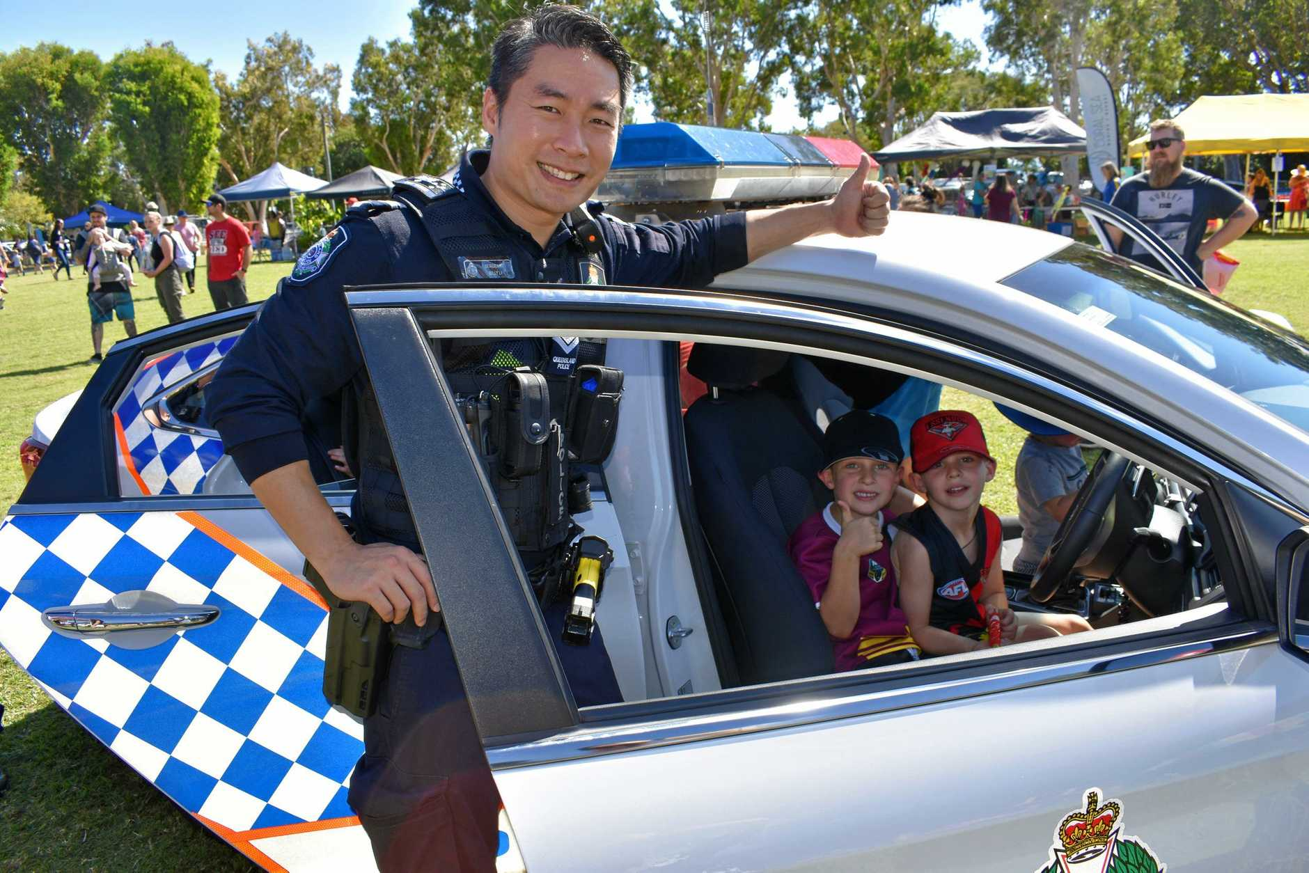 Youngsters Reef  and Jett Brookes got behind the driver's seat of a police car under the watchful eye of Sergeant Billy Li on Sunday.