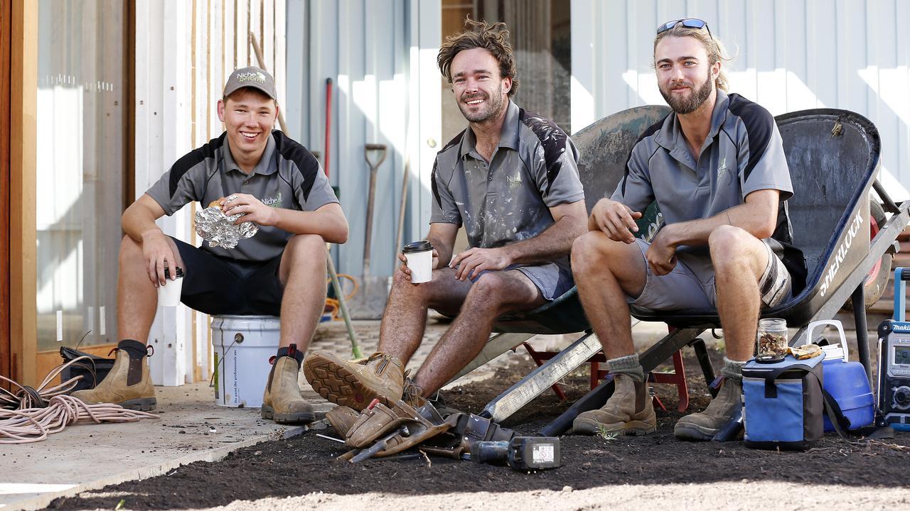 Tradies Tyson McIlveen, Josh Balkin and Jackson Woodley. Picture: Josh Woning/AAP