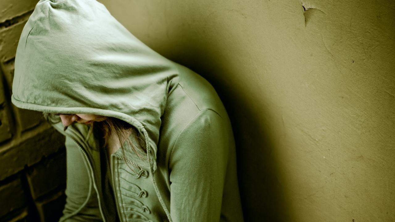 Sad Teenage Girl Shutterstock 27697063