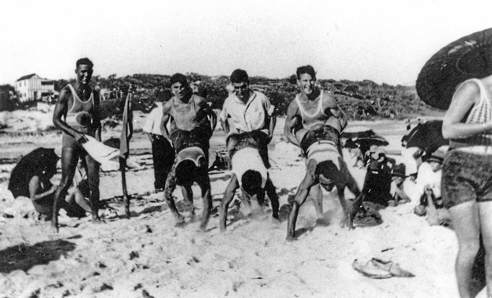 Metropolitan Life Savers getting ready to go in a wheelbarrow race on Kings Beach, ca 1929.