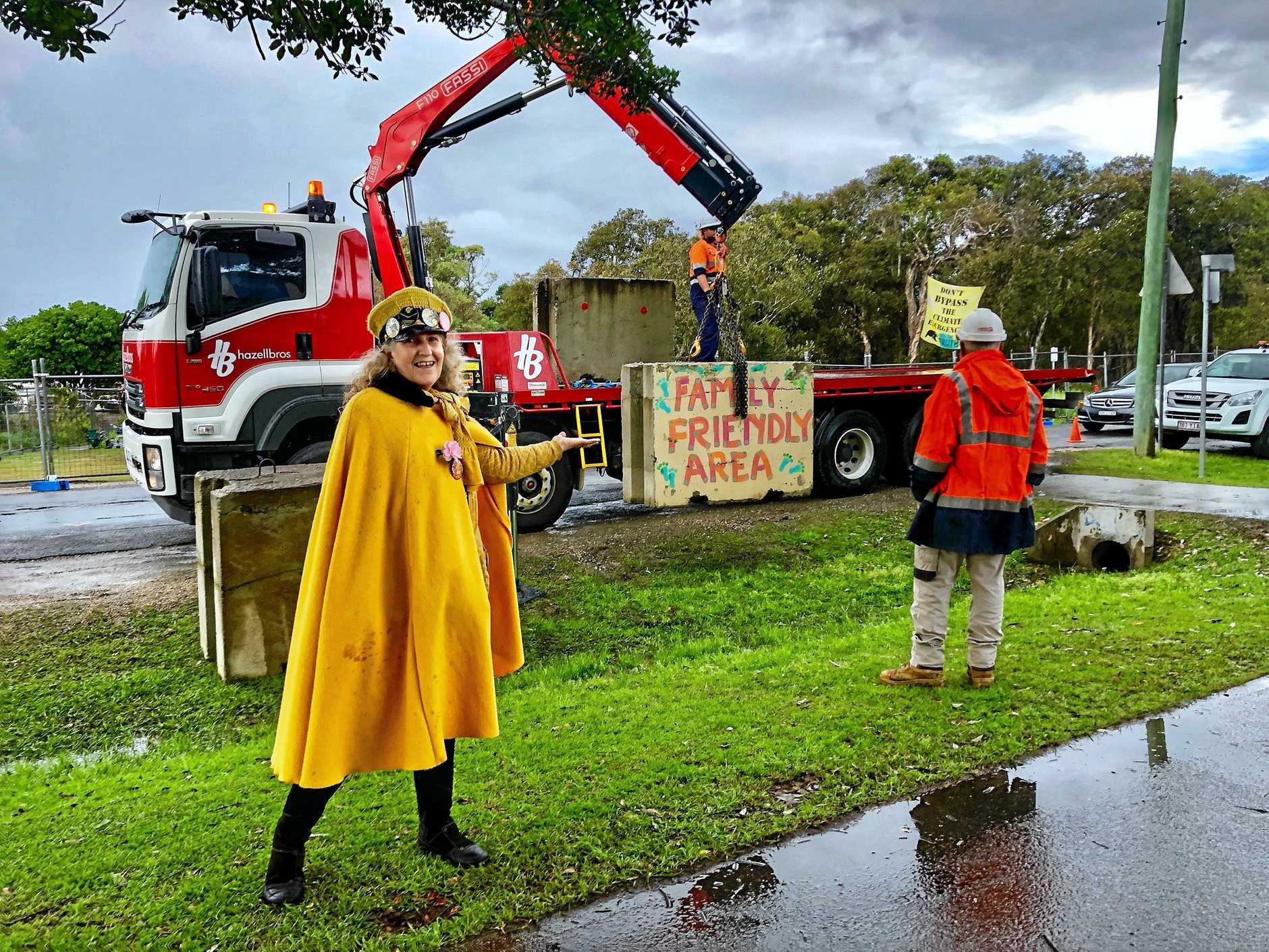 FAMILY FRIENDLY: Knitting Nanna Rosie Lea watches on as workers block access to the  Cumbebin Alliance protest camp in Butler Street Byron Bay.