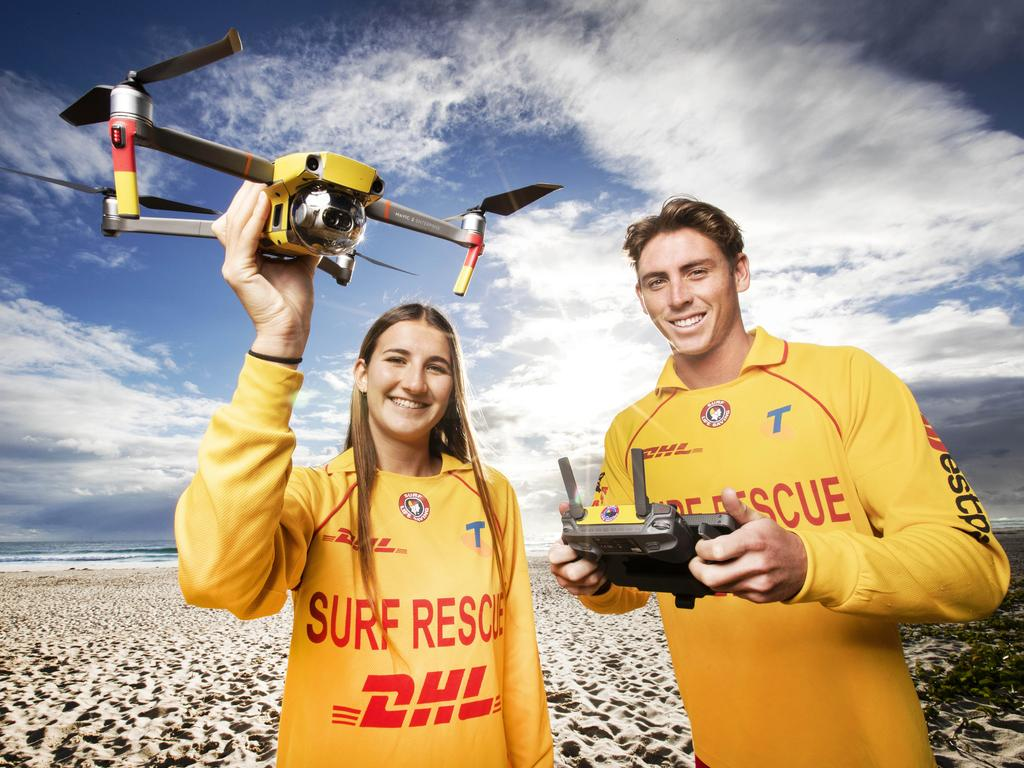 Lifesavers Chloe Jones and Angus Macphail, from Cudgen Headland SLSC, with a drone funded by Gold Coast Airport. Picture: Nigel Hallett