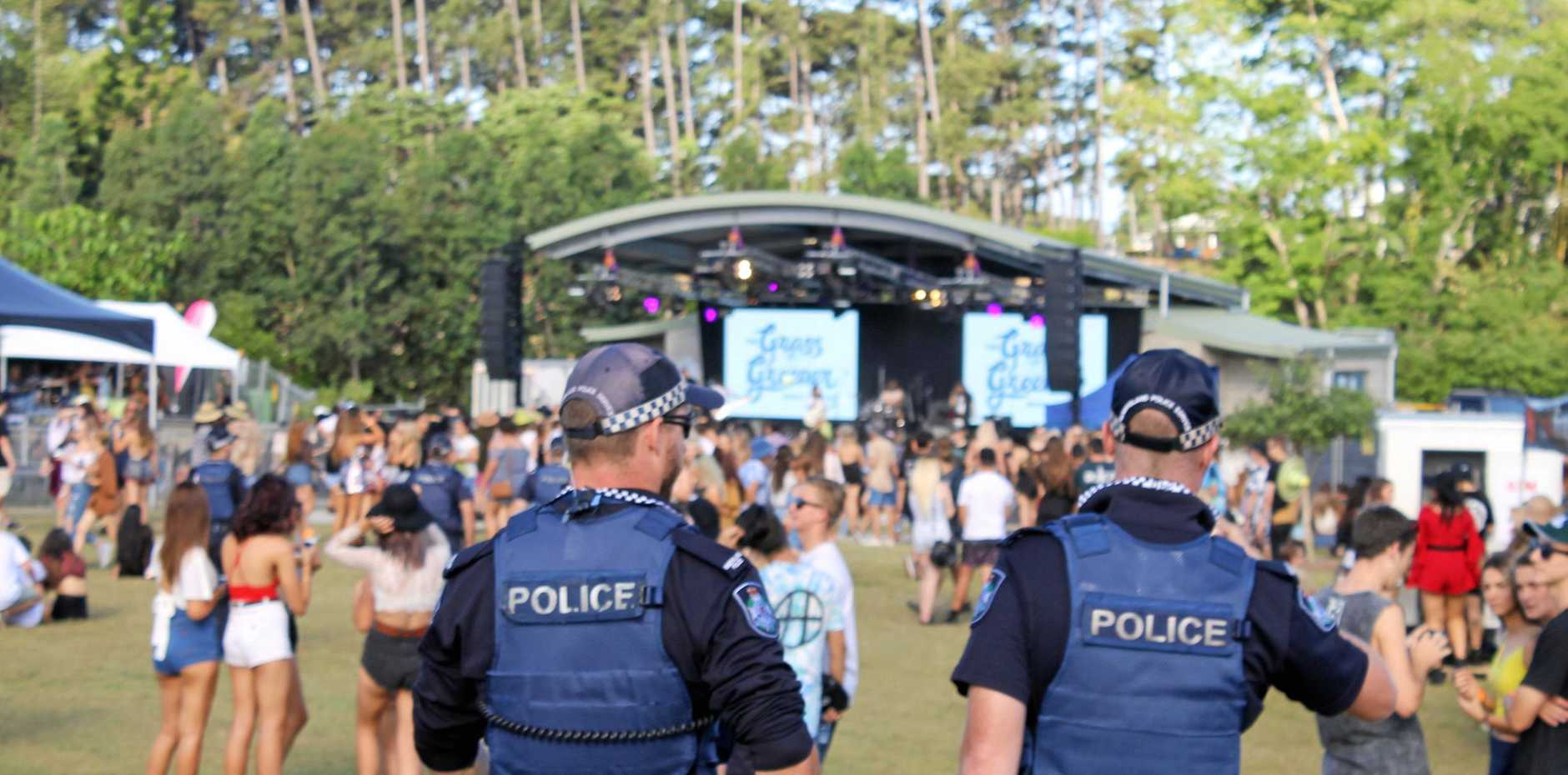 Police patrolling The Grass is Greener music festival at Mackay Botanic Gardens.