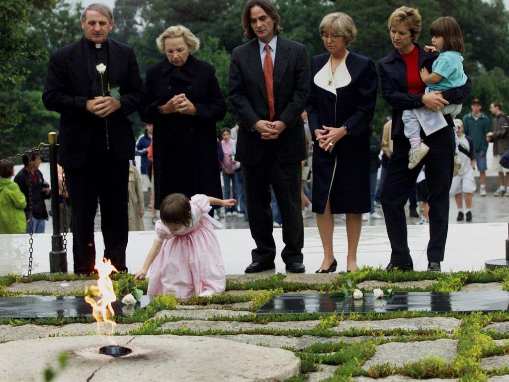 Robert F. Kennedy's granddaughter Saoirse Kennedy Hill places a white rose at the Eternal Flame in 2000. Picture: Hillery Smith Garrison/AFP