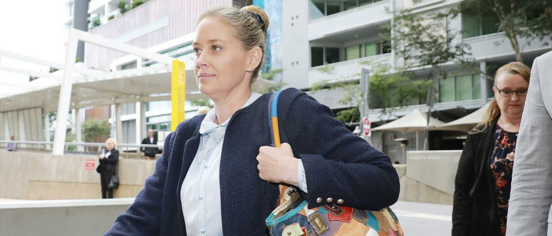 Rachel James (left) and Claire Smith (rear) leave Federal Court in Brisbane.