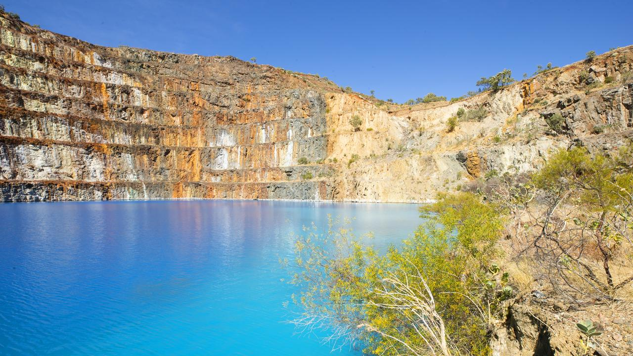 The electric blue of the Mary Kathleen dam is popular with tourists. Picture: Lachie Millard