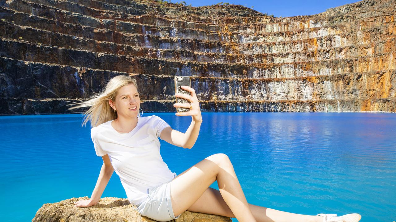 Frankie Hall takes a selfie at the abandoned Mary Kathleen uranium mine. Picture: Lachie Millard