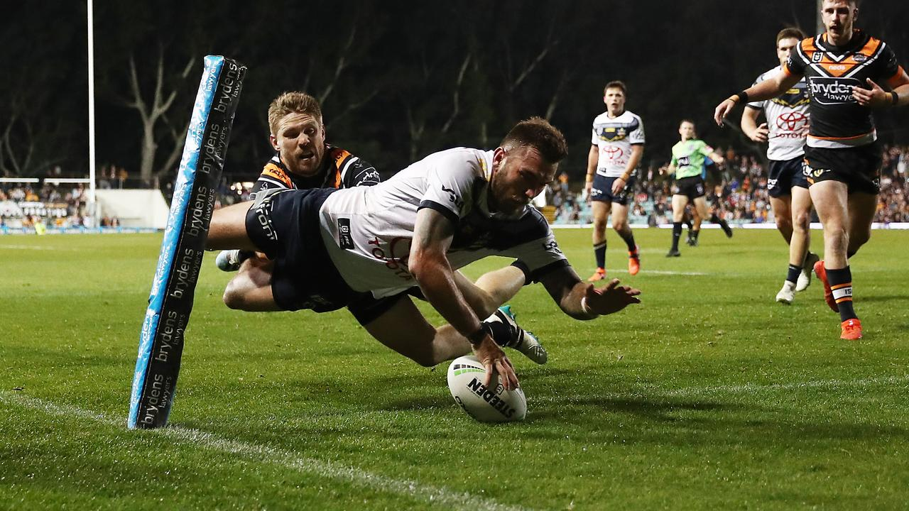 Cowboys winger Kyle Feldt dives over to score a try that was disallowed.