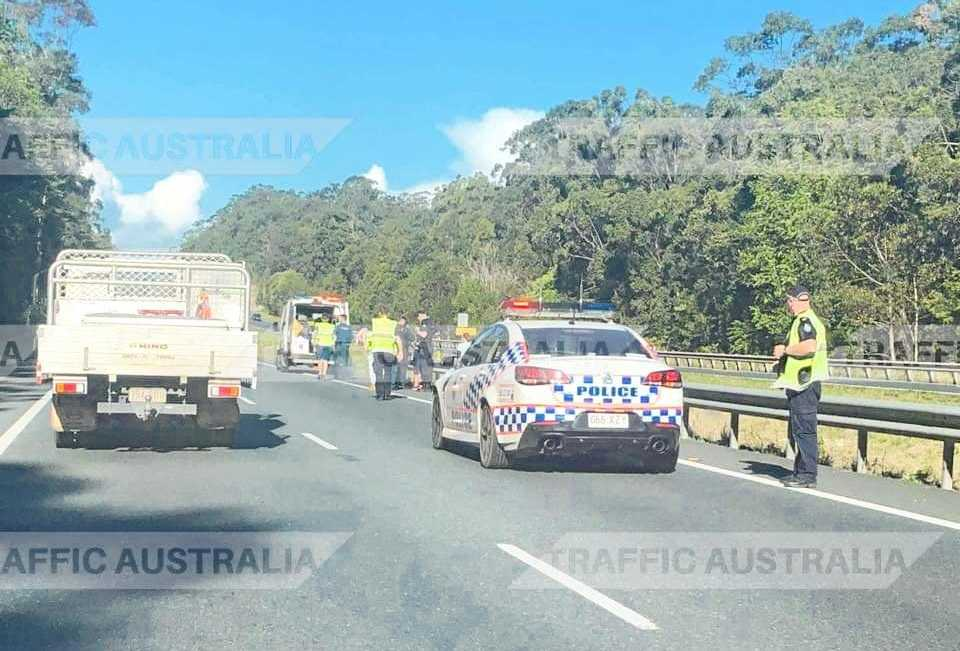 Traffic ground to a halt on the Bruce Highway at Tanawha this afternoon with a car stuck in an embankment.