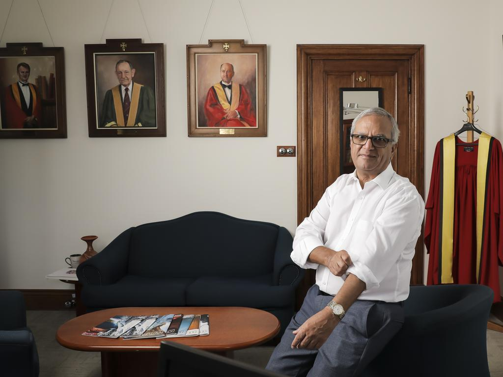 Australian Medical Association Queensland president Dr Dilip Dhupelia at AMA House in Brisbane, surrounded by portraits of former AMAQ presidents. Picture: Mark Cranitch.