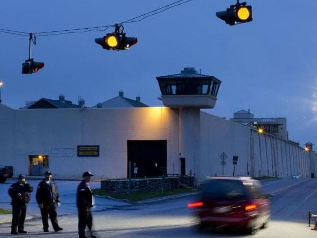 Correctional officers watch an intersection in front of Clinton Correctional Facility in Dannemora, New York. Picture: AP