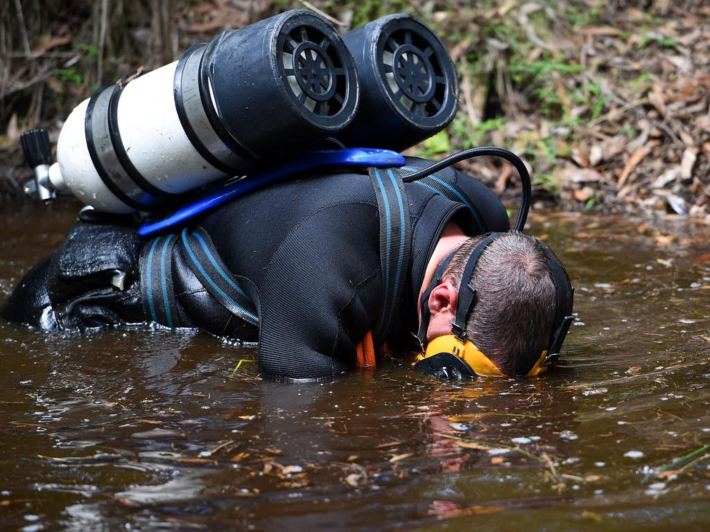 Police divers search a dam near Bonny Hills in March 2015. Picture: Dan Himbrechts.