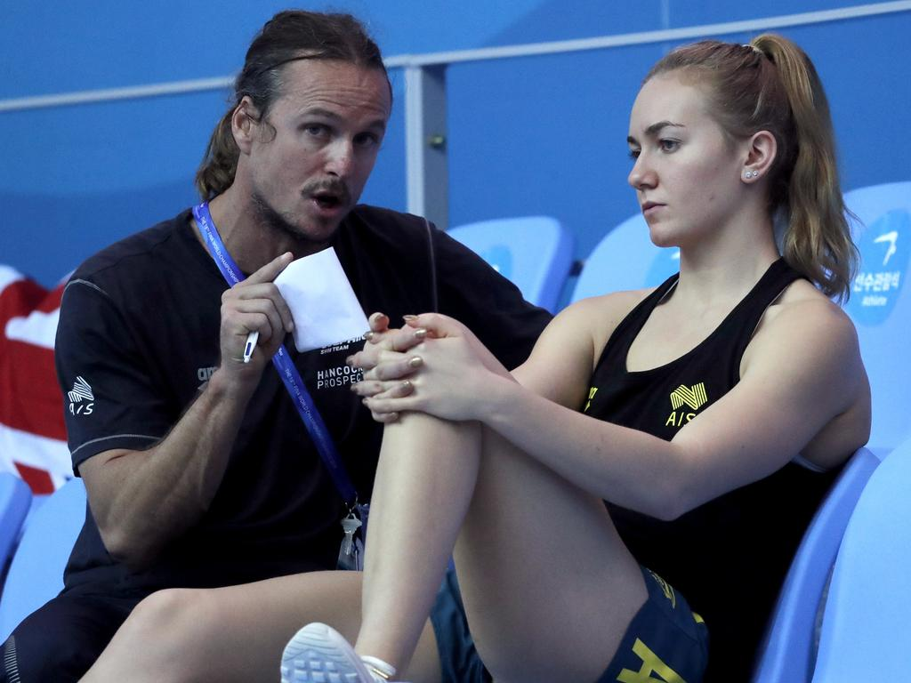 Australian swimmer Ariane Titmus talks with her coach Dean Boxall at the World Swimming Championships in Gwangju, South Korea in July. Picture: AP/Lee Jin-man
