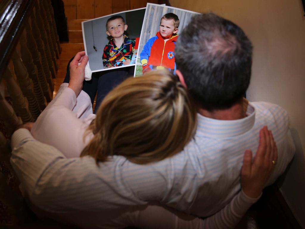 William Tyrrell's foster parents, above with pictures of the boy, took him into care in March 2012.