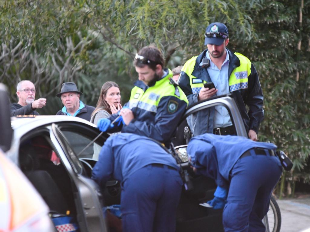 Ambulance paramedics, a Careflight crew and police treat a man sitting in a car in Coonanga Rd, Avalon, with a speargun spear in his chest. Picture: Sebastien Dekker
