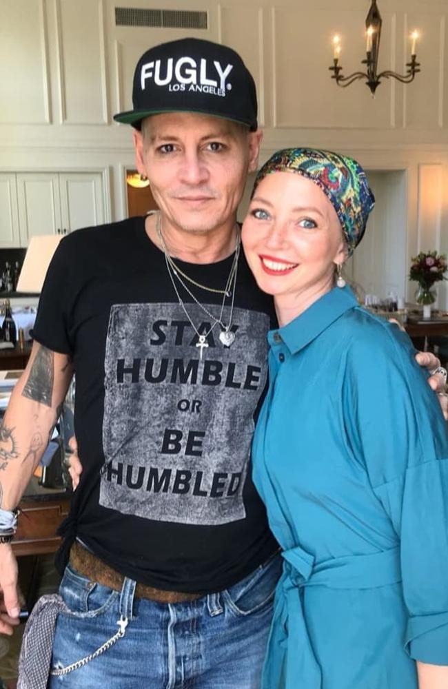Depp with a fan in St Petersburg during his tour of Russia last year, which sparked concerns for his health after he appeared pale and gaunt. Pic: Instagram/@nadezdashestakova